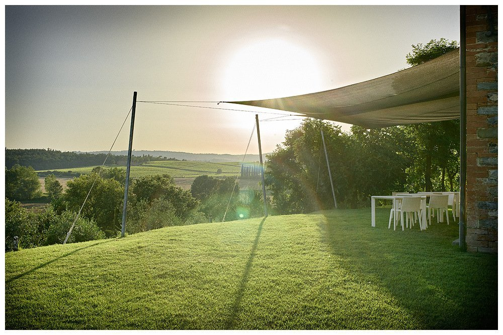 Image showing sunset over the hills of the val di chiana as seen from the lawns of the luxury villa rental and boutique hotel in tuscany siena house image by rene rickli showing from june 2017